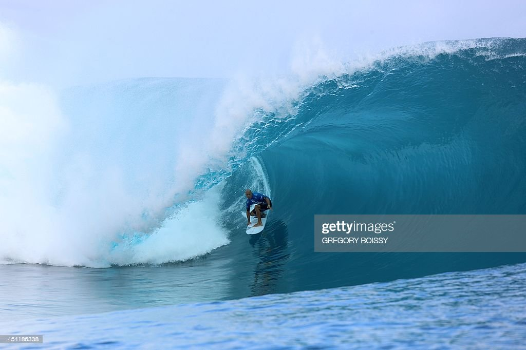 US Kelly Slater rides a wave during the finale of the 14th edition of the Billabong Pro Tahiti surf event, part of the ASP (Association of Surfing Professionals) world tour, on August 25, 2014 in Teahupoo, on the French Polynesian island of Tahiti. Brazil's Gabriel Medina won over US Kelly Slater.
