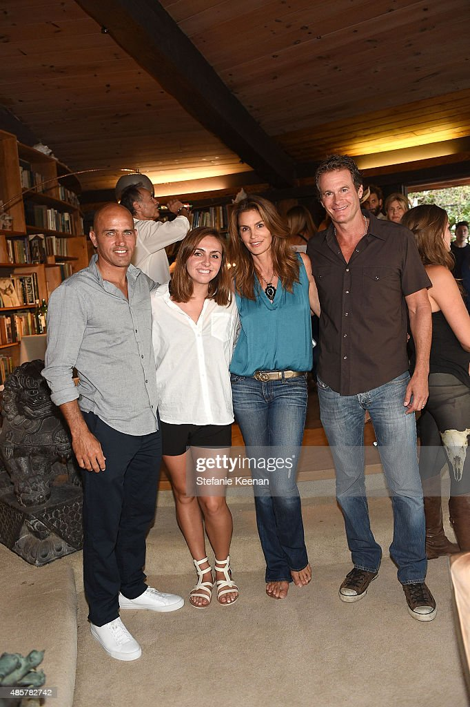 Kelly Slater, Taylor Slater, Cindy Crawford and Rande Gerber attend Kelly Slater, John Moore and Friends Celebrate the Launch of Outerknown at Private Residence on August 29, 2015 in Malibu, California.