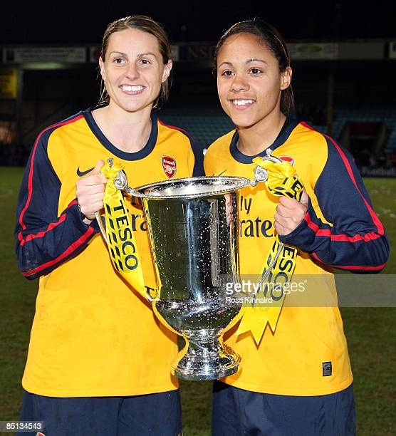 Kelly Smith and Alex Scott of Arsenal LFC pose with the winners trophy after the FA Women's Premier League Cup Final between Arsenal and Doncaster...