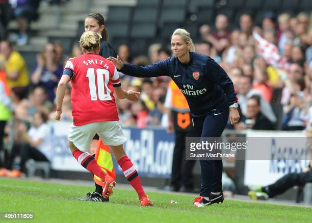 Kelly Smith celebrates scoring the 1st Arsenal goal with manager Shelly Kerr during the match at Stadium mk on June 1 2014 in Milton Keynes England