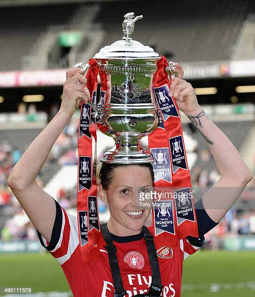 Kelly Smith of Arsenal Ladies celebrates with the trophy after winning the FA Women's Cup Final match between Everton Ladies and Arsenal Ladies at...