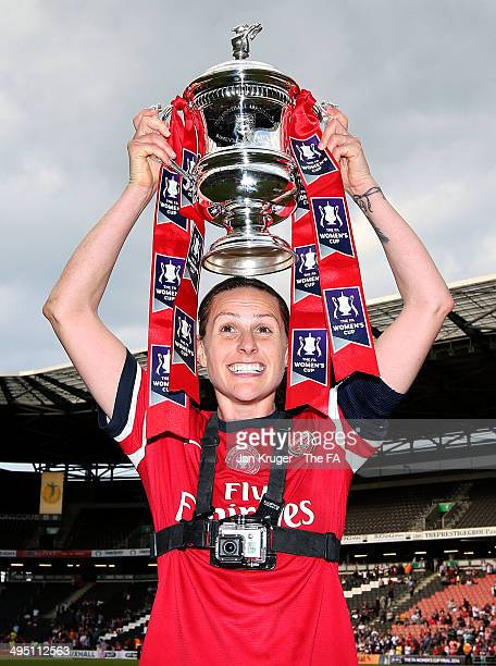 Kelly Smith of Arsenal Ladies poses with the trophy during the FA Women's Cup final between Everton Ladies and Arsenal Ladies at Stadium mk on June...