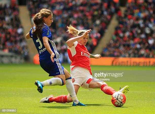 Kelly Smith of Arsenal stretches to tackle Hannah Blundell of Chelsea during the SSE Women's FA Cup Final between Arsenal Ladies and Chelsea Ladies...