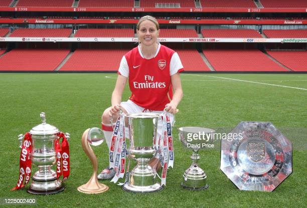 Kelly Smith of Arsenal with the Womens FA Cup Trophy Womens UEFA Cup Trophy Womens League Cup Trophy Womens Premier League Trophy and the Womens...
