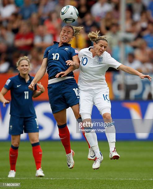 Kelly Smith of England and Camille Abily of France go up for a header during the FIFA Women's World Cup 2011 Quarter Final match between England and...