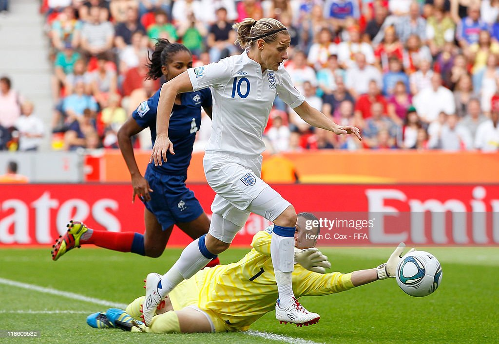 Kelly Smith of England pushes the ball past goalkeeper Celine Deville of France during the FIFA Women's World Cup 2011 Quarter Final match between England and France at the FIFA Women's World Cup Stadium Leverkusen on July 9, 2011 in Leverkusen, Germany.