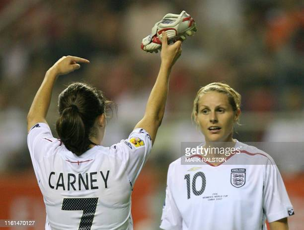 Kelly Smith of England watches as her teamate Karen Carney holds up Smith's boot after after she scored the second of her two goals against Japan...