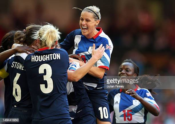 Kelly Smith of Great Britain celebrates with Casey Stoney of Great Britain after she scored a goal during the Women's Football first round Group E...