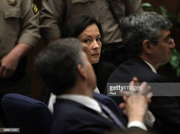 Kelly Soo Park glances at her lawyer George Buehler as they and her other lawyer Mark Kassabian listen to opening statements on May 15 2013 in Los...