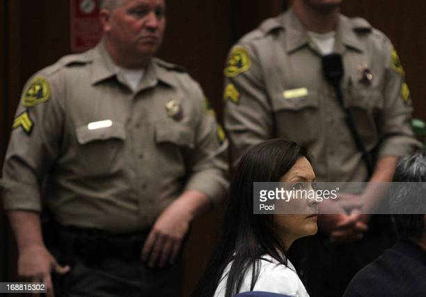 Kelly Soo Park listens to her attorney George Buehler make opening statements on May 15 2013 in Los Angeles California Park is charged with the...
