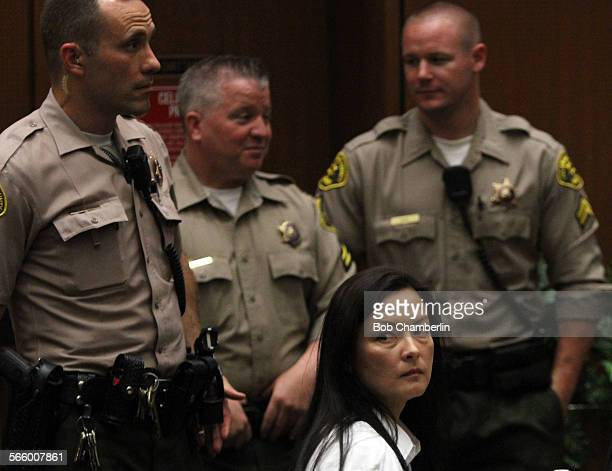 Kelly Soo Park looks back at the audience as opening motions are made on MAY 15 in her murder trial where the real estate broker is charged with the...