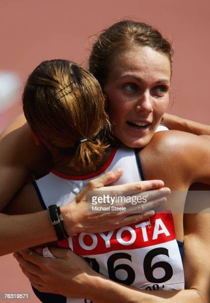 Kelly Sotherton and Jessica Ennis of Great Britain congratulate one another after running in the 100m Hurdles during the Women's Heptathlon on day...