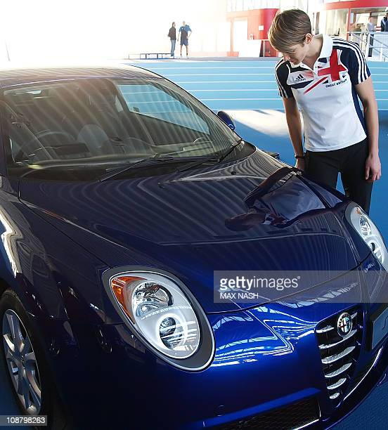 Kelly Sotherton British heptathlon and 400m athlete looks at her reflection in the new Alfa Romeo MiTo Sprint Special Edition during its launch in...