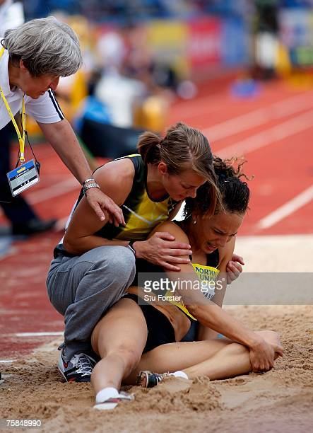 Kelly Sotherton comforts Jade Surman after Surman injured her knee in the Womens Long Jump during the Norwich Union World Trials and UK Championships...