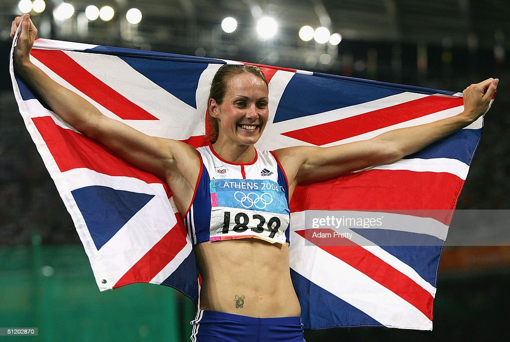 Kelly Sotherton of Great Britain celebrates with a Union Jack after the 800 metre discipline of the women's heptathlon on August 21, 2004 during the Athens 2004 Summer Olympic Games at the Olympic Stadium in the Sports Complex in Athens, Greece.