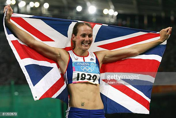 Kelly Sotherton of Great Britain celebrates with a Union Jack after the 800 metre discipline of the women's heptathlon on August 21 2004 during the...