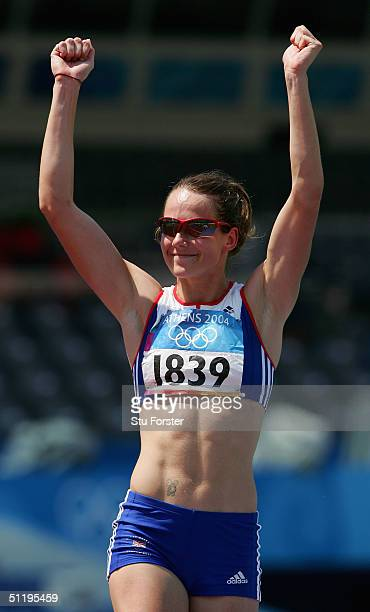Kelly Sotherton of Great Britain reacts after her jump during the high jump discipline of the women's heptathlon on August 20 2004 during the Athens...