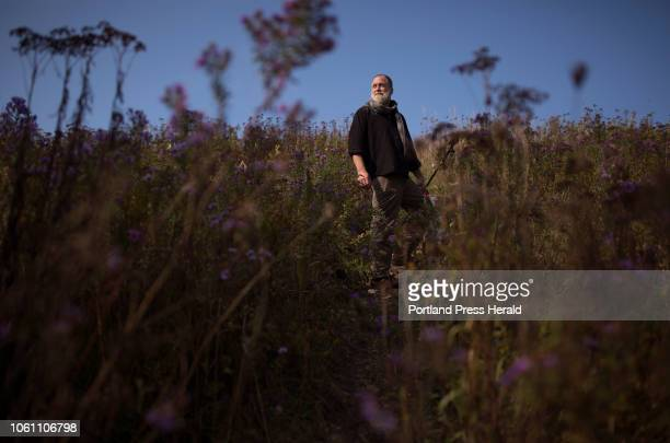 Kelly Thorndike an artist and veteran of the Iraq war poses for a portrait near the Thomaston Train Bridge along the banks of the St Georges River on...