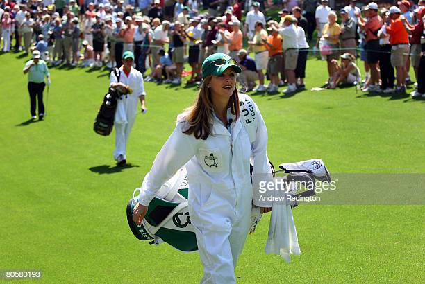 Kelly Tilghman from The Golf Channel caddies during the Par 3 Contest prior to the start of the 2008 Masters Tournament at Augusta National Golf Club...