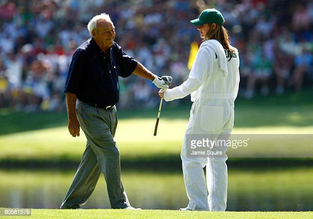 Kelly Tilghman from The Golf Channel caddies for Arnold Palmer during the Par 3 Contest prior to the start of the 2008 Masters Tournament at Augusta...