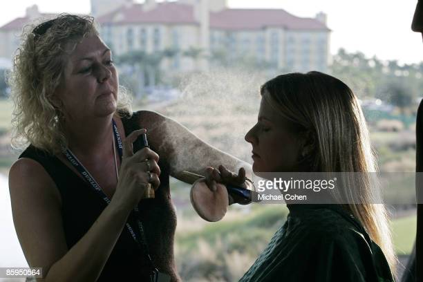 Kelly Tilghman of the Golf Channel gets makeup before broadcasting during the first round of the Merrill Lynch Shootout at the Tiburon Golf Club in...