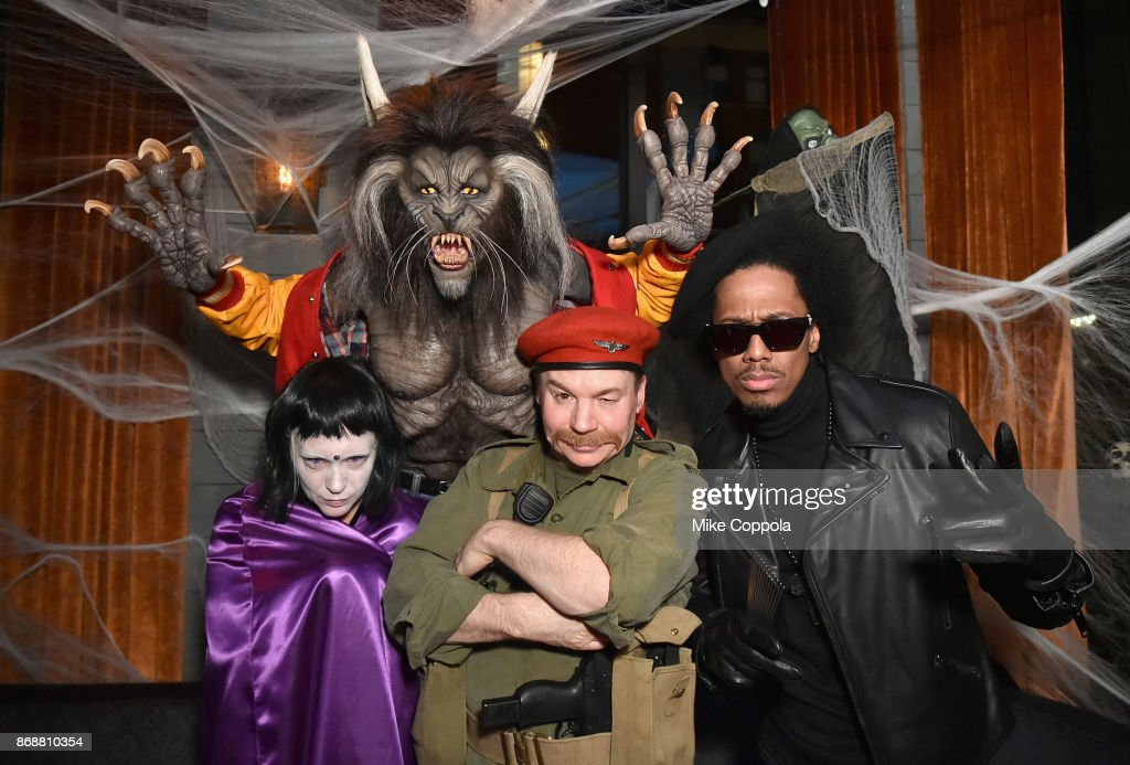 Kelly Tisdale, Heidi Klum, Mike Myers, and Nick Cannon attend Heidi Klum's 18th Annual Halloween Party presented by Party City and SVEDKA Vodka at Magic Hour Rooftop Bar & Lounge at Moxy Times Square on October 31, 2017 in New York City.