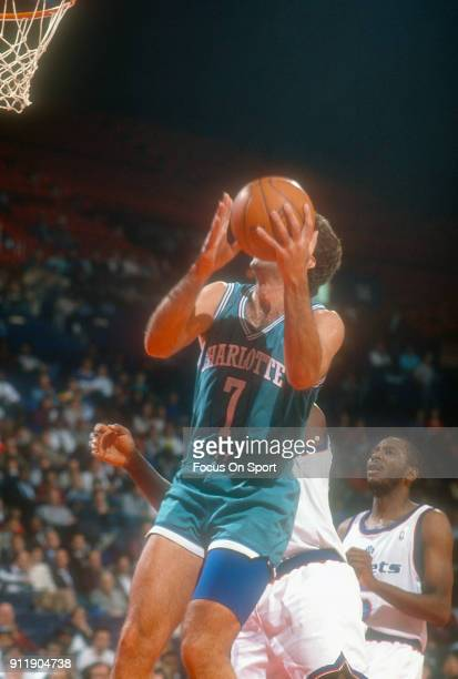 Kelly Tripucka of the Charlotte Hornets goes in for a layup against the Washington Bullets during an NBA basketball game circa 1991 at the Capital...