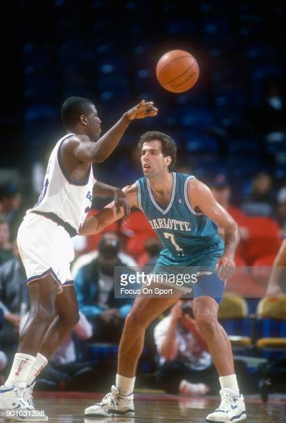 Kelly Tripucka of the Charlotte Hornets in action against the Washington Bullets during an NBA basketball game circa 1991 at the Capital Centre in...