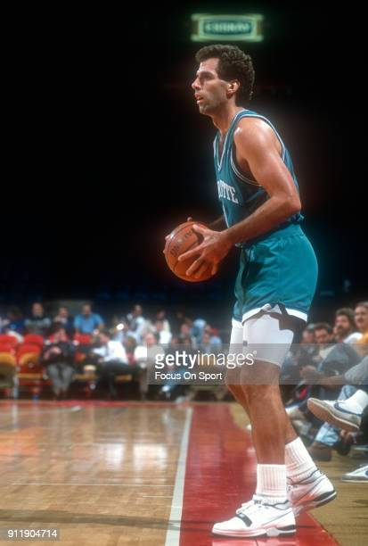 Kelly Tripucka of the Charlotte Hornets looks to pass the ball in bounds against the Washington Bullets during an NBA basketball game circa 1991 at...