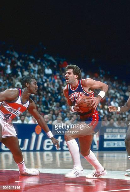 Kelly Tripucka of the Detroit Pistons drives on Rick Mahorn of the Washington Bullets during an NBA basketball game circa 1983 at the Capital Centre...