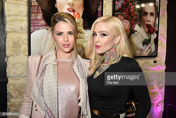 Kelly Vedovelli and Lucky Hell attend Eat My Art Stefanie Renoma Photo Exhibition at Black Gallery on March 10 2016 in Paris France