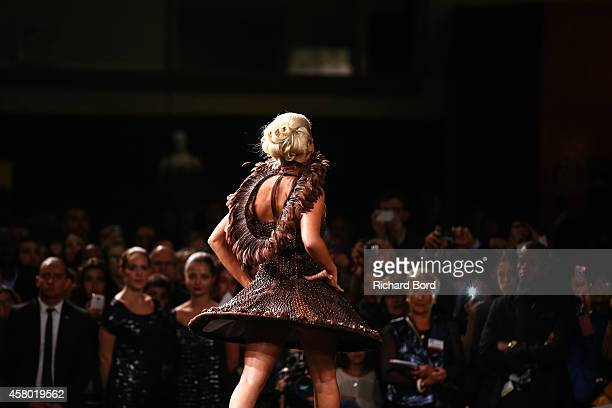 Kelly Vedovelli walks the runway and wears a chocolate dress made by stylist Nathalie Erkan and chocolate maker Franck Kestener during the Fashion...