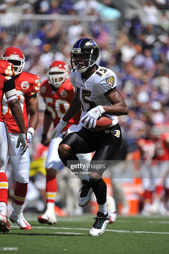 Kelly Washington #15 of the Baltimore Ravens celebrates a play against the Kansas City Chiefs at M&T Bank Stadium on September 13, 2009 in Baltimore, Maryland. The Ravens defeated the Chiefs 38-24.