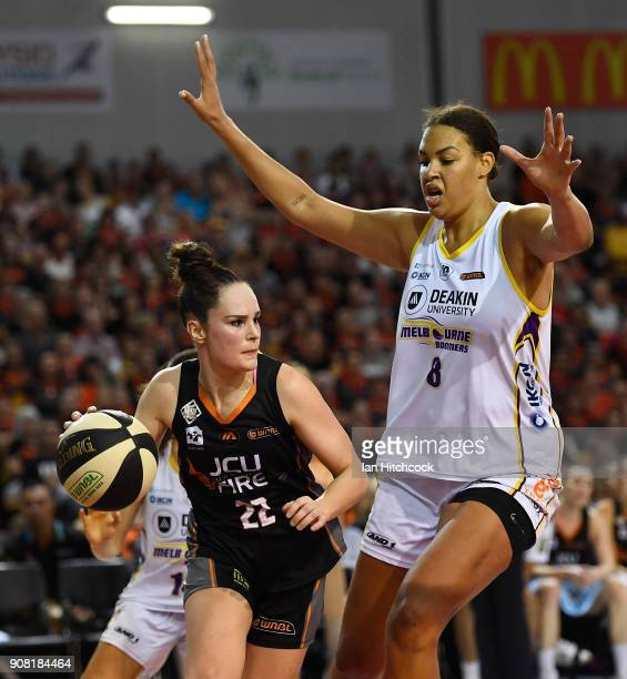 Kelly Wilson of the Fire drives to the basket past Liz Cabbage of the Boomers during game three of the WNBL Grand Final series between the Townsville...