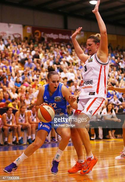 Kelly Wilson of the Spirit drives to the basket against Suzy Batkovic of the Fire during the WNBL Grand Final match between Bendigo Spirit and...