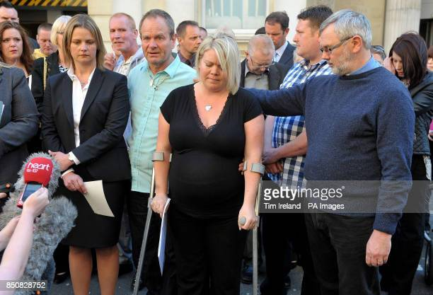 Kelly Woodruff , sister of Ross Simons, with his father Edwin Simons , makes a statement outside Bristol Crown Court, with family and friends, after...