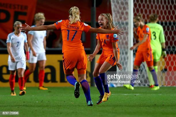 Kelly Zeeman and Jackie Groenen of the Netherlands celebrate after winning 30 the UEFA Women's Euro 2017 Second Semi Final match between Netherlands...
