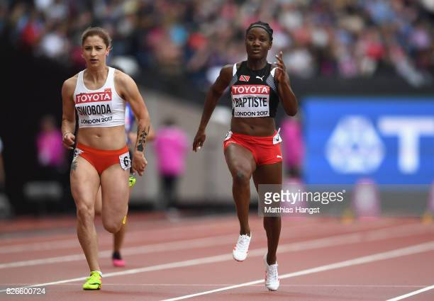 KellyAnn Baptiste of Trinidad and Tobago and Ewa Swoboda of Poland competes in the Women's 100 metres heats during day two of the 16th IAAF World...