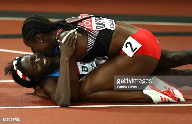 KellyAnn Baptiste of Trinidad and Tobago embraces Tori Bowie of the United States after Bowie won gold in the Women's 100 Metres Final during day...