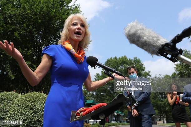 Kellyanne Conway, counselor to President Donald Trump, talks to reporters following an interview with FOX outside the White House West Wing July 07,...