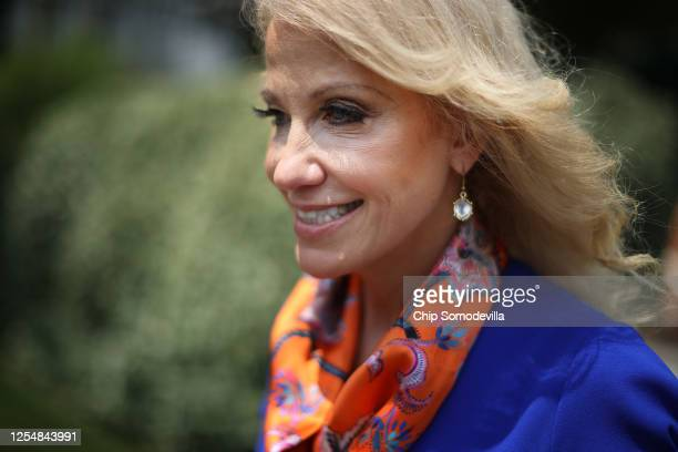 Kellyanne Conway, counselor to President Donald Trump, walks back into the West Wing following an interview with FOX outside the White House July 07,...