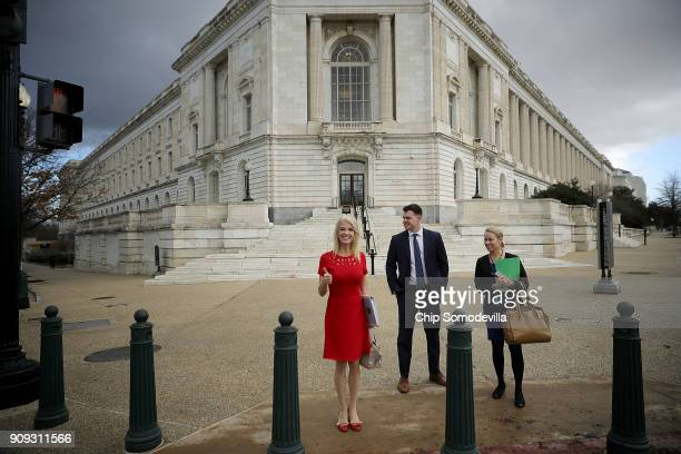 Kellyanne Conway White House Counselor to President Donald Trump gives a thumbs up before crossing Constitution Avenue outside the Russell Senate...