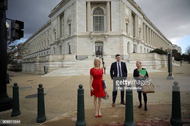 Kellyanne Conway White House Counselor to President Donald Trump waits to cross Constitution Avenue outside the Russell Senate Office Building on...