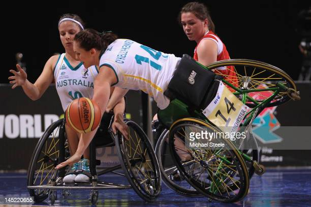 KellyKennedy of Australia loses her balance as team mate Clare Burzynski looks on with Helen Freeman of Great Britain during the Great Britain versus...