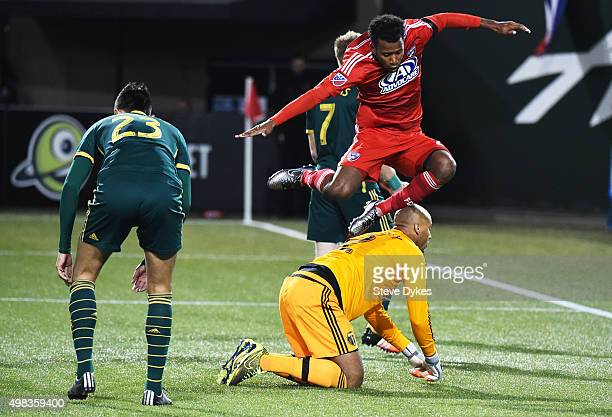 Kellyn Acosta of FC Dallas leaps over Adam Kwarasey of Portland Timbers after one of his teammates scored a goal during the second half of the match...