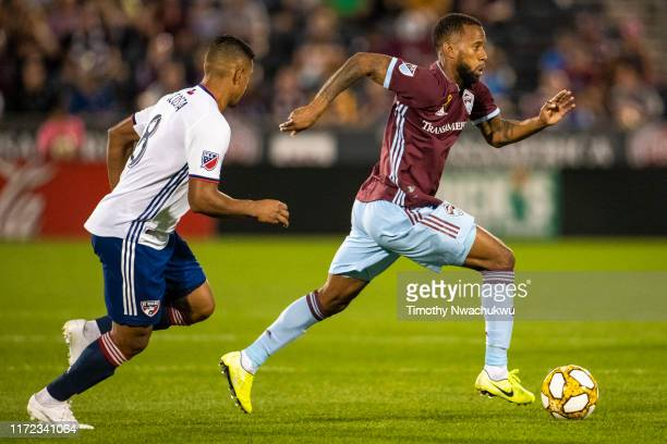 Kellyn Acosta of the Colorado Rapids dribbles past Bryan Acosta of FC Dallas during the second half at Dick's Sporting Goods Park on September 29...
