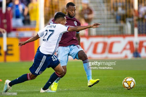 Kellyn Acosta of the Colorado Rapids dribbles past Jesús Ferreira of FC Dallas during the first half at Dick's Sporting Goods Park on September 29...