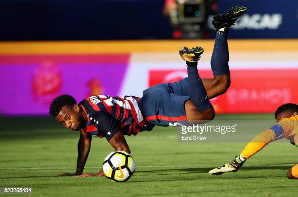 Kellyn Acosta of the United States collides with Andre Blake of Jamaica during the 2017 CONCACAF Gold Cup Final at Levi's Stadium on July 26 2017 in...