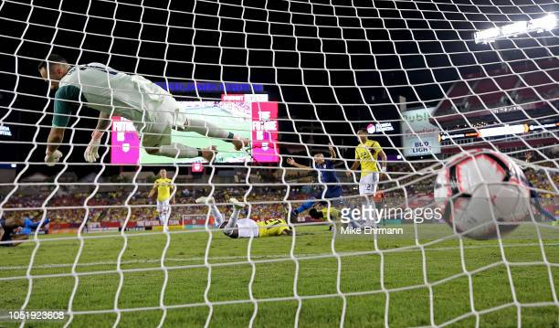 Kellyn Acosta of Unites States scores a goal on David Ospina of Colombia during an International Friendly at Raymond James Stadium on October 11,...