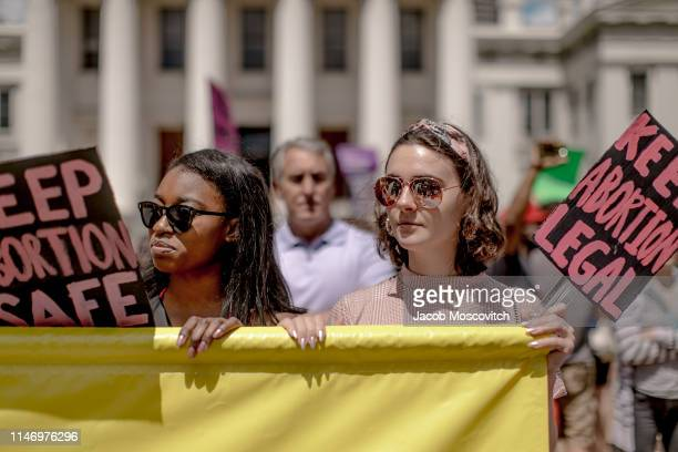 Kellyn Nettles and Colleen McGrath hold up a sign during a rally to protest the closure of the last abortion clinic in Missouri on May 30 2019 in St...